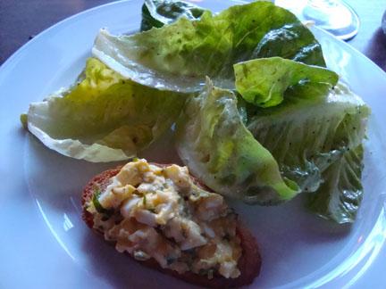 Creative growers Little Gem & Red Oak Lettuces, Creamy Lemon Vinaigrette, and Truffled Farm Egg & Spring Herb Toasts