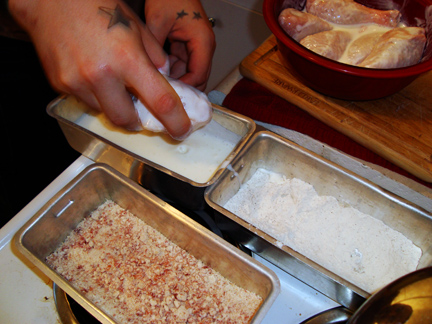 dredging chicken in seasoned flour, buttermilk, and bacon meal